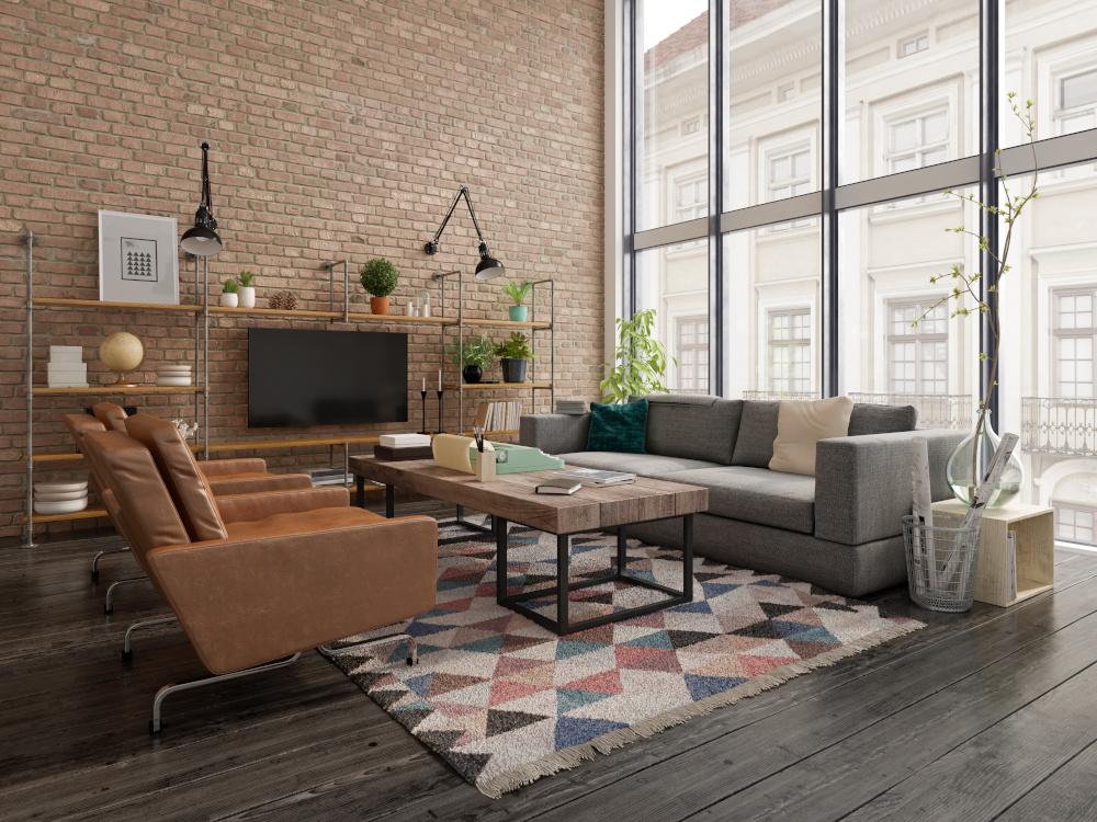 salon w mieszkaniu urządzony w stylu loftowym